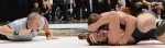 Missouri heavyweight Devon Mellon is pinned by Oklahoma State's Alan Gelogaev, giving up key team points. Mizzou gambled by starting Mellon in place of top-ranked Dom Bradley.