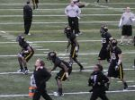 Gary Pinkel (top center) watches over his players as they participate in drills at the first day of practice on Tuesday, March 12, 2013 at Dan Devine Indoor Pavilion in Columbia.