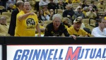 Fans Mandy, Bev and Ed Reynolds yell at officials from court side during Wednesday's game.