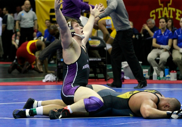 No. 5 seed Michael McMullan from Northwestern celebrates his win over Missouri's Dom Bradley Friday, March 22 at the NCAA wrestling tournament in Des Moines, Iowa. Bradley was the No. 1 seed in the 285 pound division.