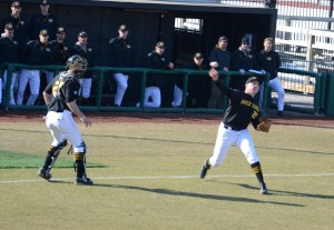 Pitcher Keaton Steele spins and fires to get the Eastern Michigan runner at first.