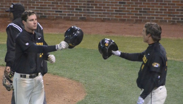 Missouri left fielder Dane Opel (left) is greeted by teammate Case Munson (right) after Opel homered in the bottom of the fourth of game two on Tuesday. The home run was Opel's second of the day, who had four hits and batted in five runs over the course of Tuesday's doubleheader against Arkansas State.