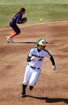Missouri's Jenna Marston heads to third base as shortstop Kacey Rogers mishandles the ground ball.