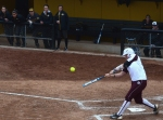 Texas A&M's Nicole Morgan hits a grand slam as the Mizzou bench watches.