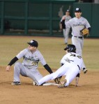 San Francisco second baseman Jason Mahood (left) and Missouri center fielder Logan Pearson look to the second base umpire for a ruling on Pearson's attempted steal in the sixth inning of Friday's game. Pearson was ruled safe.