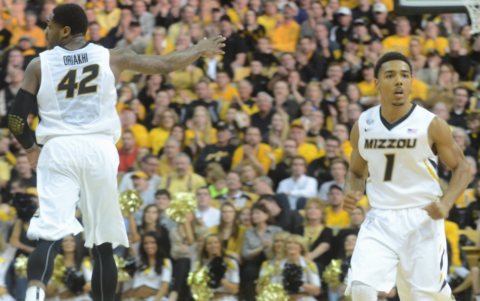 Alex Oriakhi (42) and Phil Pressey (1) get back on defense after Oriakhi scored two of his 18 points. Oriakhi finished the game with a double-double.