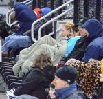 Fans attending Tuesday's games layer themselves with blankets, heavy coats and sleeping bags. A scheduled game on Wednesday was moved up to Tuesday to create a doubleheader.