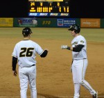 Keeton Steele (right) gives first base coach Dan Pietroburgo a fist bump after reaching on an error in the eighth inning of Friday's 6-2 win over San Francisco.