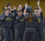 Missouri's Mackenzie Sykes is greeted at home by her teammates after hitting her third home run of the season.