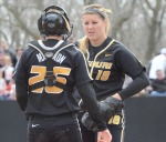 Missouri catcher Jenna Marston talks to pitcher Chelsea Thomas after she allows Arkansas hitters to reach base