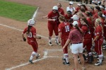 Arkansas' players celebrate Chloe Oprzedek's (20)  two-run home run that pushed Arkansas' lead to 4-1 in the fifth inning.