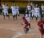 Missouri players celebrate Taylor Gadbois' (9) game-tying run in the seventh inning.