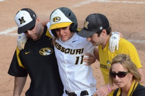 Missouri's Kayla Kingsley (11) is helped off the field after injuring herself running the bases in the eighth inning in Sunday's game against Arkansas at University Field.