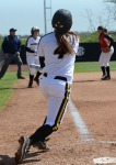 Missouri's Mackenzie Sykes (4) hits a ball foul with Nicole Hudson on third base in the fifth inning.  Sykes stranded seven base runners in game one.