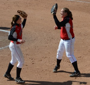 Western Kentucky's Emily Rousseau (right) high fives teammate Preslie Cruce after winning game one, 1-0 on April 24, 2013 at University Field in Columbia.