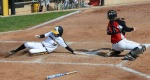 Missouri's Corrin Genovese (16) slides in to give the Tigers a 1-0 lead in the first inning of game two.