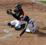 Missouri's Emily Crane (2) slides in at home as the Tigers extend its lead 2-0 in game two.  Coach Ehren Earleywine pulled Crane in the first game for not sliding into home and a fielding miscue.