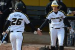 Missouri's Jenna Marston (26) high fives Carlie Rose after scoring to extend the Tigers' lead to 3-0 in game two.