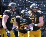 Henry Josey (20) celebrates his touchdown with linemen Justin Britt (68) and Max Copeland (61).