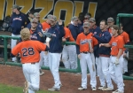 Auburn first baseman Garrett Cooper (28) is congratulated by teammates after hitting his second home run of the game on Friday. Cooper had three hits and batted two runs in during Auburn's 3-1 win over Missouri.