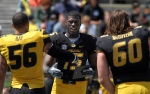 Dorial Green-Beckham (15) prepares to shake hands with Shane Ray during half time ceremonies and Connor McGovern looks on. Green-Beckham was awarded most improved wide receiver for the spring session.