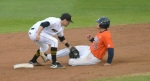 Missouri shortstop Dillon Everett (left) applies a tag to Auburn third baseman Damek Tomscha (25) to end the top of the sixth inning of Friday's game. Tomscha was caught stealing on the play.