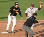 Dylan Kelly (55) is called out at second base, after trying to advance on a passed ball.