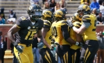 Dorial Green-Beckham (15) heads to the sidelines as the defense celebrates intercepting a pass meant for him. Green-Beckham was admonished for not turning into a defender on the play.