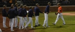 Auburn starting pitcher Conner Kendrick (orange shirt) exits Friday's game after eight and one-thirds innings of work. Kendrick allowed three runs on eight hits while striking out 11 Tigers, and picked up his third win of the season in the strong outing.