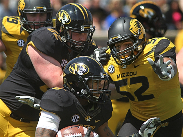 Offensive lineman Taylor Chappell (62) holds off defensive lineman Michael Sam (52) as Marcus Murphy (6) turns up field for a small gain.