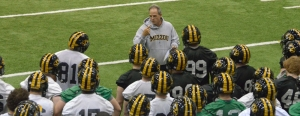 Coach Gary Pinkel (facing camera) talks to the Tigers about the Black & Gold Game. The game is scheduled for Saturday at 1 p.m. at Faurot Field.