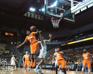 Players and crowd look on as Missouri's Liene Priede has her shot blocked by Tennessee's Kamiko Williams February 3, 2013 at Mizzou Arena. Missouri recorded its highest crowd for the season in its game against Tennessee - 4,181.
