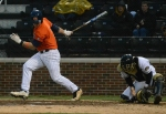 Auburn left fielder Cullen Wacker (left) strikes out swinging as Missouri catcher Dylan Kelly (right) grips the ball during the eighth inning of Friday's game.