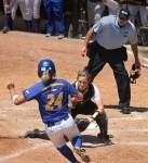 Missouri catches Jenna Marston waits to tag Hofstra's Caryn Bailey for the out at home. Watching is home plate umpire Kevin Wallace.