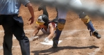 Princess Krebs slides safely into home, scoring Missouri's only run of the game.
