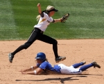 After the throw goes wide, Corrin Genovese jumps over Hofstra's Caryn Bailey as she slides safely into second base.