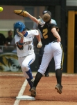 Hofstra's Chloe Fitzgerald reaches first safely as Missouri's Emily Crane is unable to catch the throw.