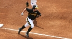 Nicole Hudson rounds third base and heads home to score for Missouri.