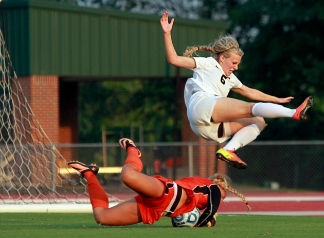 Missouri's Reagan Russell (6) jumps over Pacific goalie Tashia Long as Long grabs the ball. Russell scored twice in the 5-1 win Friday night. Photo by Karen Mitchell.
