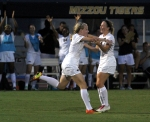 Regan Russell (left) and Kaysie Clark celebrate Russell's second goal of the game, in the second quarter.