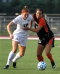 Sarah Thune (13) and Maricela Padilla (8) fight for control of the ball.