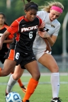 Nicole Penick (6) and Lauren Flynn (11) fight for the ball.