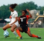 Senior Dominique Richardson (2) maneuvers around Pacific defender Nicole Penick (6).