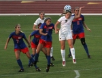 Missouri's Kaysie Clark (9) heads the ball surrounded by SMU players.