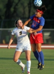 Kaysie Clark (9) watches as SMU's Taylor Robinson (15) heads the ball.
