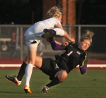 Missouri's Reagan Russell collides with SMU goalie Lauryn Bodden (1).