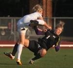Missouri's Reagan Russell collides with SMU goalie Lauryn Bodden (1).