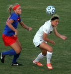 Missouri's Melanie Donaldson heads the ball in front of SMU's Bari Kesner.
