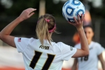 Lauren Flynn throws in the ball to teammate Taylor Grant (18).