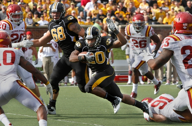 Henry Josey busts through a hole in the Iowa State line in this October 15, 2011 photo. He sustained a season-ending injury a month later. Photo by Karen Mitchell.